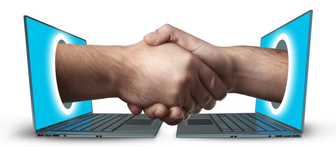 Image of a smart-contract, two computers handshaking